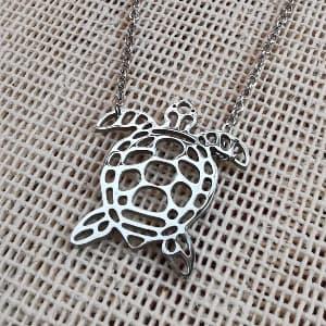 Dije de tortuga marina de acero inoxidable